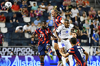 KANSAS CITY, KS - JULY 15: Walker Zimmerman #5 of the United States heads the ball during a game between Martinique and USMNT at Children's Mercy Park on July 15, 2021 in Kansas City, Kansas.