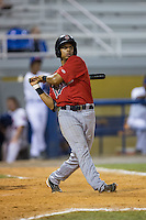 Kamran Young (27) of the Elizabethton Twins follows through on his swing against the Kingsport Mets at Hunter Wright Stadium on July 9, 2015 in Kingsport, Tennessee.  The Twins defeated the Mets 9-7 in 11 innings. (Brian Westerholt/Four Seam Images)