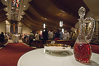 Communion wine and wafers sit on the offerings table at the rear of a Catholic church in Westerville, Ohio, during the Holy Saturday service.<br />