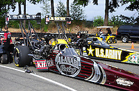 Aug. 5, 2011; Kent, WA, USA; The cars of NHRA top fuel dragster driver Larry Dixon (left) an Tony Schumacher in the staging lanes during qualifying for the Northwest Nationals at Pacific Raceways. Mandatory Credit: Mark J. Rebilas-