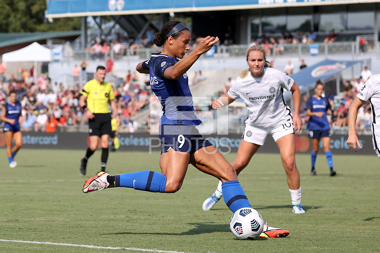 CARY, NC - SEPTEMBER 12: Lynn Williams #9 of the North Carolina Courage crosses the ball during a game between Portland Thorns FC and North Carolina Courage at Sahlen's Stadium at WakeMed Soccer Park on September 12, 2021 in Cary, North Carolina.