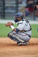 Danville Braves catcher Carlos Martinez (8) on defense against the Burlington Royals at Burlington Athletic Park on July 12, 2015 in Burlington, North Carolina.  The Royals defeated the Braves 9-3. (Brian Westerholt/Four Seam Images)