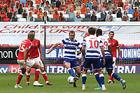 George Puscas of Reading in action as Charlton's pop up fans look on from behind the goal during Charlton Athletic vs Reading, Sky Bet EFL Championship Football at The Valley on 11th July 2020