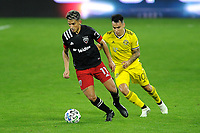 WASHINGTON, DC - OCTOBER 28: Yamil Asad #11 of D.C. United battles for the ball with Lucas Zelarayan #10 of Columbus Crew SC during a game between Columbus Crew and D.C. United at Audi Field on October 28, 2020 in Washington, DC.