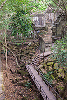 Cambodia, Beng Mealea, 12th. Century.  Walkway through Sanctuary Ruins.