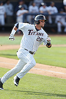 J.D. Davis #26 of the Cal State Fullerton Titans runs the bases during a game against the Washington State Cougars at Goodwin Field on  February 15, 2014 in Fullerton, California. Washington State defeated Fullerton, 9-7. (Larry Goren/Four Seam Images)