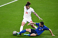11th July 2021; Wembley Stadium, London, England; 2020 European Football Championships Final England versus Italy; Kalvin Phillips is slide tackled by Federico Chiesa