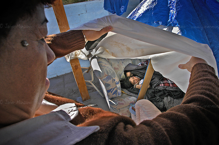 Immigrant Shelter. Yuma AZ. Immigrants arrive at all times of the night, and get a chance to rest and regain energies.