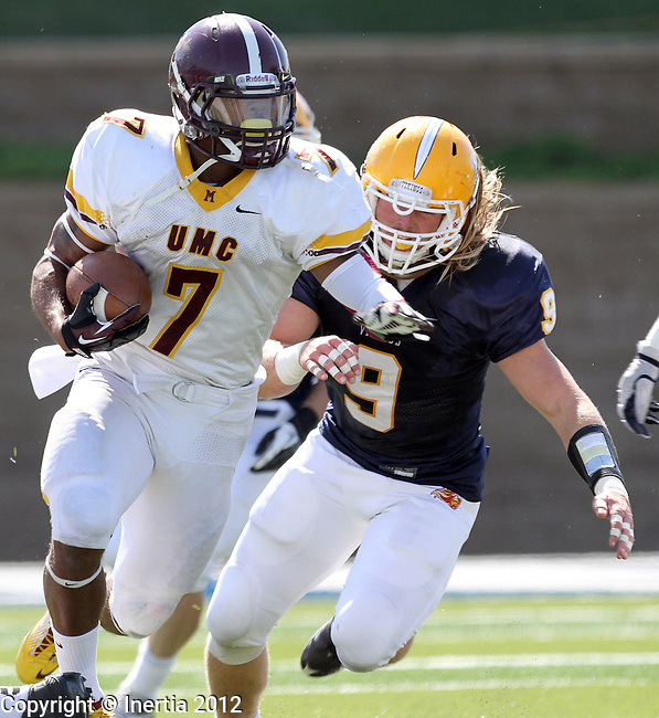 SIOUX FALLS, SD - SEPTEMBER 15:  Richard Haley #7 from the University of Minnesota Crookston runs past Nate Kirby #9 from Augustana in the first quarter Saturday afternoon at Augustana. (Photo by Dave Eggen/Inertia)