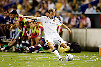 LA Galaxy midfielder Eddie Lewis sending a ball over the middle. The LA Galaxy defeated Chivas USA 1-0 to win the final edition of the 2009 SuperClásico at Home Depot Center stadium in Carson, California on Saturday, August 29, 2009...
