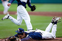 Brandon Healy (14) of the Oral Roberts Golden Eagles lands hard after making a diving catch on a short hit to the infield during a game against the Missouri State Bears on March 27, 2011 at Hammons Field in Springfield, Missouri.  Photo By David Welker/Four Seam Images