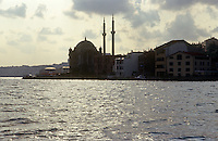 The pinacles of Dolmabahce Mosque rise up from the banks of the shimmering Bosphorus