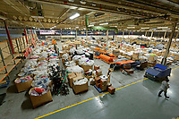 """COPY BY TOM BEDFORD<br /> Pictured: The 100 box-pallets in storage at the John Pye Auctions warehouse in Pyle, south Wales, UK.<br /> Re: A bride cried tears of joy after her missing wedding dress was found among a pile of 20,000 gowns in a warehouse.<br /> Meg Stamp, 27, paid £1,300 for the beautiful ivory lace dress but it  was seized by liquidators after a bridal company went bust.<br /> It was boxed up along with 20,000 others and due to be sold for a knock-down price at auction.<br /> But determined Meg banged on the auctioneer door saying: """"I want my dress back"""".<br /> Staff at John Pye auctioneers in Port Talbot spent three hours sifting through boxes until they finally found Meg's dream dress."""