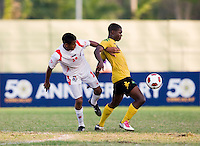 Romario Jones (8) of Jamaica gets away from Alfredo Stephens (19) of Panama during the third place game of the CONCACAF Men's Under 17 Championship at Catherine Hall Stadium in Montego Bay, Jamaica. Panama defeated Jamaica, 1-0.
