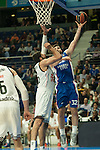 Real Madrid´s Ioannis Bourousis and Anadolu Efes´s Deniz Kilicli during 2014-15 Euroleague Basketball match between Real Madrid and Anadolu Efes at Palacio de los Deportes stadium in Madrid, Spain. December 18, 2014. (ALTERPHOTOS/Luis Fernandez)