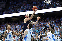 CHAPEL HILL, NC - NOVEMBER 06: John Mooney #33 of the University of Notre Dame takes a layup over Andrew Platek #3 and Rechon Leaky Black #1 of the University of North Carolina during a game between Notre Dame and North Carolina at Dean E. Smith Center on November 06, 2019 in Chapel Hill, North Carolina.