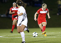 BOYDS, MARYLAND - April 06, 2013:  Lori Lindsey (6) of The Washington Spirit makes a pass against the University of Virginia women's soccer team in a NWSL (National Women's Soccer League) pre season exhibition game at Maryland Soccerplex in Boyds, Maryland on April 06. Virginia won 6-3.