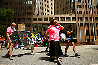 A protest organized by Trans YOUniting matched through downtown from the UPMC offices on Friday July 31, 2020 in Pittsburgh, Pennsylvania. (Photo by Jared Wickerham/Pittsburgh City Paper)