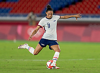 YOKOHAMA, JAPAN - JULY 30: Christen Press #11 of the USWNT takes her penalty kick during a game between Netherlands and USWNT at International Stadium Yokohama on July 30, 2021 in Yokohama, Japan.
