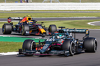 18th July 2021; Silverstone Circuit, Silverstone, Northamptonshire, England; Formula One British Grand Prix, Race Day; Aston Martin Cognizant F1 Team driver Lance Stroll in his Aston Martin AMR21 Mercedes-AMG F1 M12 ahead of Red Bull Racing Honda driver Sergio Perez in his Red Bull Racing RB16B Honda RA621H