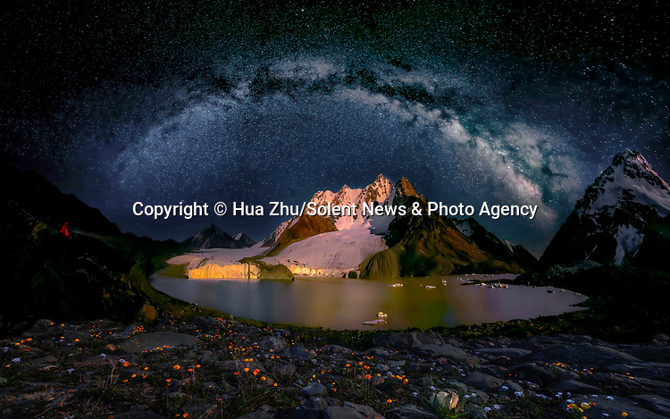 Pictured: The Milky Way at Tian Shan, Xinjiang, China<br /> <br /> This beautiful series of photographs shows the Milky Way as seen from different continents around the world.   Photographer Hua Zhu travelled the globe over the course of four years to capture the starry night sky from already stunning locations. <br /> <br /> The medical professor visited picturesque landmarks in the USA, Kenya, New Zealand and China, including the Great Wall in Beijing.  Chinese Dr Zhu, who lives in New Jersey, USA, said he meticulously planned the trips by researching when the Milky Way would be on show.   SEE OUR COPY FOR DETAILS<br /> <br /> Please byline: Hua Zhu/Solent News<br /> <br /> © Hua Zhu/Solent News & Photo Agency<br /> UK +44 (0) 2380 458800