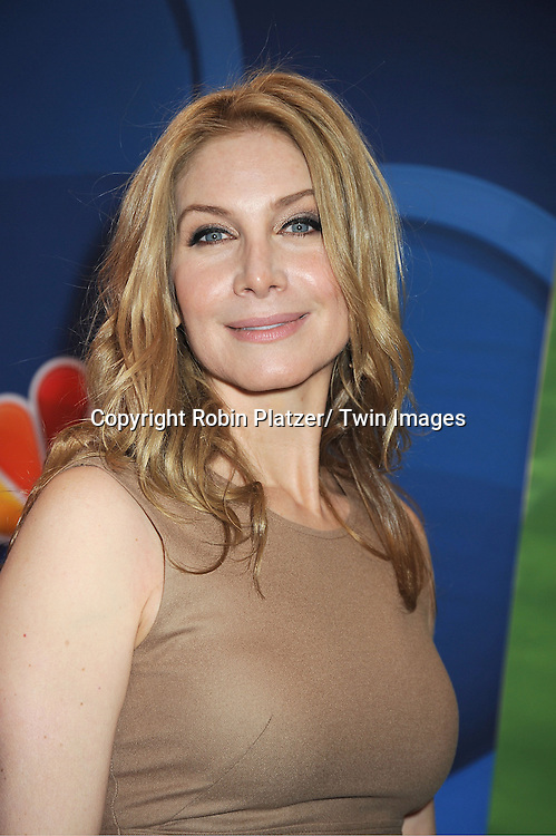 Elizabeth Mitchell arrives at the NBC Upfront Presentation for 2013-2014 Season on May 13, 2013 at Radio City Music Hall in New York City.