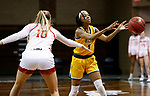 SIOUX FALLS, SD - MARCH 8: Reneya Hopkins #0 of the North Dakota State Bison passes the ball away from the defense of Morgan Hansen #10 of the South Dakota Coyotes during the Summit League Basketball Tournament at the Sanford Pentagon in Sioux Falls, SD. (Photo by Richard Carlson/Inertia)