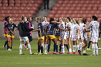 SANDY, UT - OCTOBER 03: Utah Royals FC and Portland Thorns FC players exchange pleasantries after a game between Portland Thorns FC and Utah Royals FC at Rio Tinto Stadium on October 03, 2020 in Sandy, Utah.