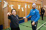 St Johnstone players took some festive cheer to Fairview School in Perth gving out selection boxes and gifts to the pupils…Alan Mannus dancing with Jordan a secondary school pupil<br />Picture by Graeme Hart.<br />Copyright Perthshire Picture Agency<br />Tel: 01738 623350  Mobile: 07990 594431