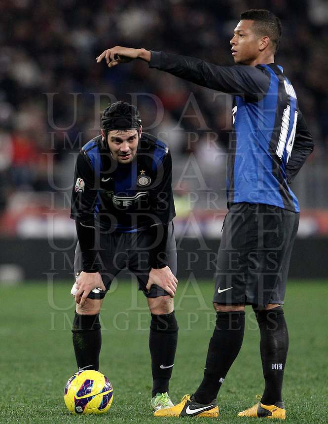 Calcio, semifinale di andata di Coppa Italia: Roma vs Inter. Roma, stadio Olimpico, 23 gennaio 2013..FC Inter defender Cristian Chivu, of Romania, left, and midfielder Fredy Guarin, of Colombia, prepare to kick a free kick during the Italy Cup football semifinal first half match between AS Roma and FC Inter at Rome's Olympic stadium, 23 January 2013..UPDATE IMAGES PRESS/Riccardo De Luca