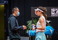 Den Bosch, The Netherlands, April 16, 2021,    Maaspoort, Billy Jean King Cup  Netherlands -  China , First Match: Xinyu Wang (CHN) on the bench with captain Shuo Liu.<br /> Photo: Tennisimages/Henk Koster