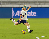 ORLANDO, FL - JANUARY 22: Julie Ertz #8 passes the ball during a game between Colombia and USWNT at Exploria stadium on January 22, 2021 in Orlando, Florida.