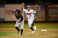 Great Falls Voyagers shortstop Lency Delgado (12) chases Cam Coursey (11) during a Pioneer League game against the Missoula Osprey at Centene Stadium at Legion Park on August 19, 2019 in Great Falls, Montana. Missoula defeated Great Falls 1-0 in the second game of a doubleheader. (Zachary Lucy/Four Seam Images)
