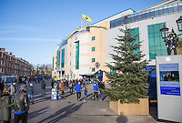 General view of the Stadium - Premier League Flag flies above Chelsea Football Club as supporters make there way past the christmas tree before the English Premier League match between Chelsea and Bournemouth at Stamford Bridge, London, England on 26 December 2016. Photo by Andy Rowland.