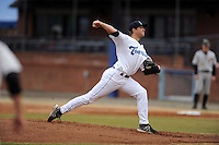 Asheville Tourists starting pitcher Konner Wade #34 delivers a pitch during game one of a double header against the West Virginia Power at McCormick Field on April 8, 2014 in Asheville, North Carolina. The Power defeated the Tourists 6-5. (Tony Farlow/Four Seam Images)