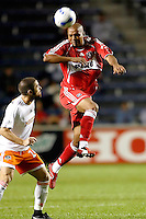 Chicago Fire forward Andy Herron (26) heads the ball in front of Houston Dynamo defender Wade Barrett (24).  The Chicago Fire and the Houston Dynamo tied 2-2 at Toyota Park in Bridgeview, IL on August 30, 2006..