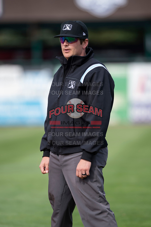 Umpire Jeff Hamann during a Midwest League game between the Kane County Cougars and Cedar Rapids Kernels at Northwestern Medicine Field on April 28, 2019 in Geneva, Illinois. Kane County defeated Cedar Rapids 3-2 in game one of a doubleheader. (Zachary Lucy/Four Seam Images)
