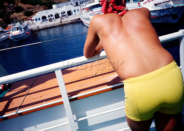 Man in yellow swim trunks on a ferry