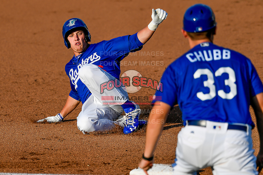 Luke Raley (36) of the Ogden Raptors hustles towards third base against the Idaho Falls Chukars in Pioneer League action at Lindquist Field on June 28, 2016 in Ogden, Utah. The Raptors defeated the Chukars 12-11.  (Stephen Smith/Four Seam Images)