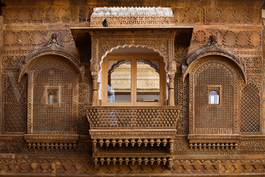 Intricately carved sandstone WINDOW SCREENS in the MAHARAJA'S PALACE located inside JAISALMER FORT - RAJASTHAN, INDIA
