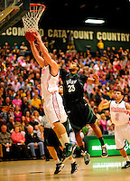 13 February 2011: University of Vermont Catamount forward Brian Voelkel, a Freshman from Pleasantville, NY, goes up for a rebound against guard Robert Mansell, a Freshman from  Glenside, PA, of the Binghamton University Bearcats at Patrick Gymnasium in Burlington, Vermont. The Catamounts came from behind to defeat the Bearcats 60-51 in their America East matchup. The Cats took part in the National Pink Zone Breast Cancer Awareness Program by wearing special white jerseys with pink trim. The jerseys were auctioned off following the game with proceeds going to the Vermont Cancer Center. Mandatory Credit: Ed Wolfstein Photo