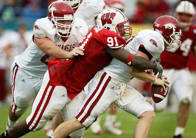 Defensive lineman Jason Chapman performs the sole Wisconsin sack on Razorback quarterback Tracy Dick.<br />