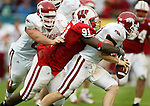 Defensive lineman Jason Chapman performs the sole Wisconsin sack on Razorback quarterback Tracy Dick.<br />
