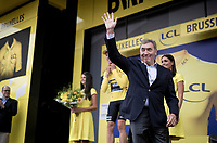 Eddy Merckx hands out the yellow jersey to stage winner Mike Teunissen (NED/Jumbo-Visma) who is the first yellow jersey wearer in the 2019 Tour de France<br /> <br /> Stage 1: Brussels to Brussels (BEL/192km) 106th Tour de France 2019 (2.UWT)<br /> <br /> ©kramon