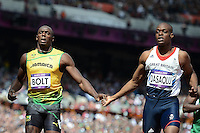 Usain Bolt Jamaica e James Dasaolu Gran Bretagna.London 04/08/2012 .London 2012 Olympic games  - Men s 100m Heat of Athletics - Olimpiadi Londra 2012 - 100m Uomini Atletica.Olympic Stadium.Foto Imago / Insidefoto.ITALY ONLY..