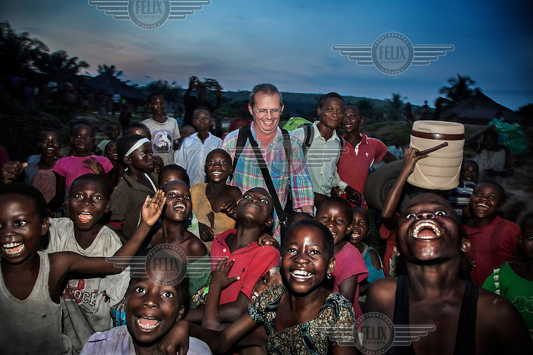 Surrounded by excited children, Dr Richard Hardi and his medical team are welcomed on the banks of the Sankuru River at the remote village of Pania. <br /> <br /> From his base in Mbuji Mayi Hungarian ophthalmologist Friar Richard Hardi and his team travelled deep into the Congolese rainforest, by 4x4 and canoe, to treat people in isolated communities most of whom have never seen an ophthalmologist. At a small village called Pania they established a temporary field hospital and over the next three days made hundreds of consultations. Although both conditions are preventable, many of the patients they saw had Glaucoma or River Blindness (onchocerciasis) that had permanently damaged their eyesight. However, patients with cataracts, a clouding of the eye's lens, who were suitable for treatment were booked for an operation. For two days the team carried out the ten minute procedure on one patient after another. The surgery involves making a 2.2mm incision into the remove the damaged lens that is then replaced by an artificial one. Doctor Hardi is one of the few people willing to make such a journey but is inspired to do so by his faith and, as he says: 'Here I feel that I can really make a difference in people's lives'. /Felix Features