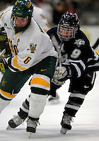 "5 January 2007: University of New Hampshire forward Jacob Micflikier (9) from Winnipeg, MB, battles University of Vermont defenseman Kenny Macaulay (6) from Baddeck, NS, during a game at Gutterson Fieldhouse in Burlington, Vermont. The UNH Wildcats defeated Vermont 7-1 in front of a record setting 48th consecutive sellout at ""the Gut""...Mandatory Photo Credit: Ed Wolfstein Photo.<br />"