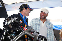 Feb 7, 2014; Pomona, CA, USA; UFC fighter Randy Couture (right) talks with NHRA funny car driver Ron Capps during qualifying for the Winternationals at Auto Club Raceway at Pomona. Mandatory Credit: Mark J. Rebilas-