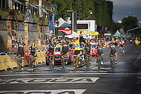 Chris Froome (GBR/SKY) wins the 2015 Tour de France and rides over the finish line in Paris with his teammates by his side. Quite a sight as just then the sun peaks through the Paris clouds and shines some light onto the victorious pack.<br /> <br /> stage 21: Sèvres - Champs Elysées (109km)<br /> 2015 Tour de France