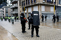 BOGOTA, COLOMBIA - MAY 05: Police officers stands guard during national strike on May 5, 2021 in Bogota, Colombia. Despite that the ruling party announced withdrawal of the unpopular bill for a tax reform and the resignation of the Minister of Finances, social unrest continues after a week. The United Nations human rights office (OHCHR) showed its concern and condemned the riot police repression. Ongoing protests take place in major cities since April 28. (Photo by Leonardo Munoz/VIEW press/Corbis via Getty Images)
